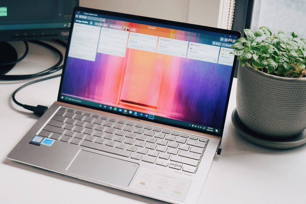 Trello is a great tool to use to help you organise your family history (Image: Pexels - https://www.pexels.com/photo/black-and-gray-laptop-computer-on-white-table-7044653/)
